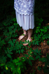 woman bare feet in the forest