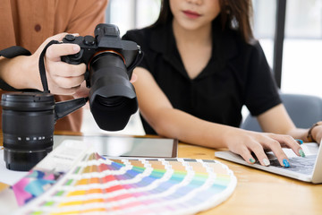 Photo artist and graphic desginer selecting pictures from camera