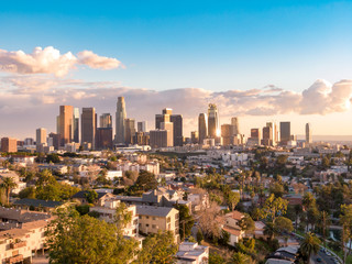 Aerial view of downtown Los Angeles city skyline and skyscrapers on a sunny day.