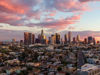 Drone shot from above of downtown Los Angeles city skyline and skyscraper buildings during golden hour