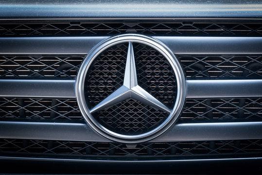 Mercedes Benz logo close up on the car