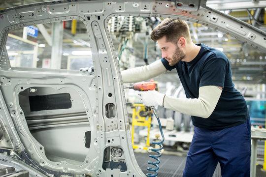 Man working in modern car factory