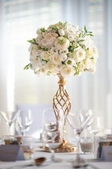 wedding table with flowers and decorations, wedding centerpiece or event reception