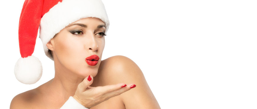 Christmas banner with beautiful woman in Santa hat sending a kiss