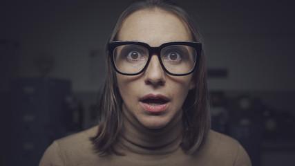 Shocked scared woman staring at camera
