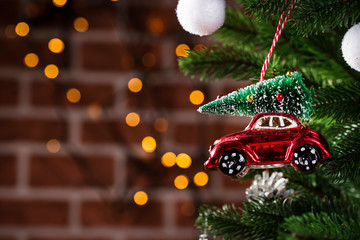 Fotorolgordijn Vintage cars Christmas tree toy in shape of red car