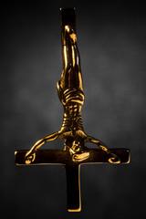 Falling Golden Satanic Crucifix