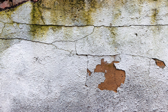 old white wall with cracks. abstract ruin architecture texture. devastation background concept. close up view