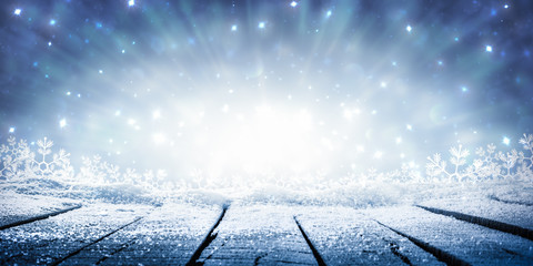 Wooden Plank Table With Sparkling Snow And Brilliant Explosion Background - Winter Display
