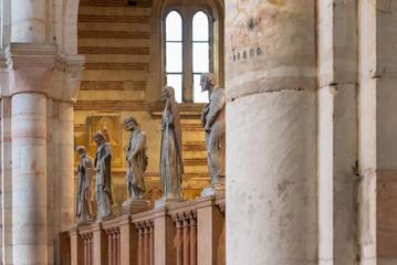Sculptures of saints in line decorating interior of catholic church in Verona