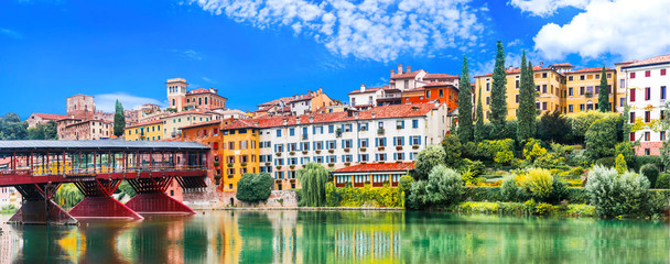 Foto op Plexiglas Olijf Beautiful medieval towns of Italy -picturesque Bassano del Grappa .Scenic view with famous bridge. Vicenza province, region of Veneto