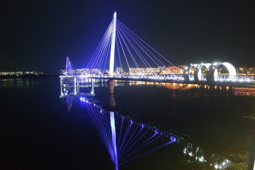 Night view of a beautiful scene of bridge over sea water in the evening time.