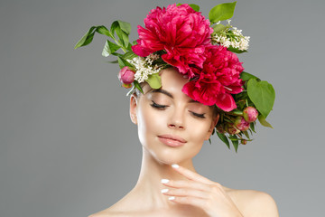 Beauty woman with flowers on head. Happy beautiful girl on gray banner background. Pretty model with clear skin. Spring fashion photo. Summertime portrait