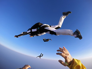 Point of view of a skydiver jumping from the plane.