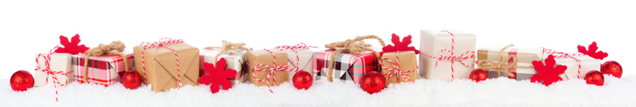 Christmas border of rustic red, white, brown and plaid gift boxes in snow. Side view isolated on a white background.