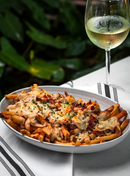 Nachos cheese loaded french fries - mexican cuisine, outside restaurant in a summer day