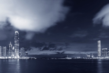 Fototapete - Panorama of Skyline and harbor of Hong Kong city at dusk