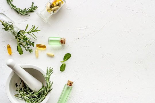 Apothecary of natural wellness and self-care. Herbs and medicine on white background top view frame copy space