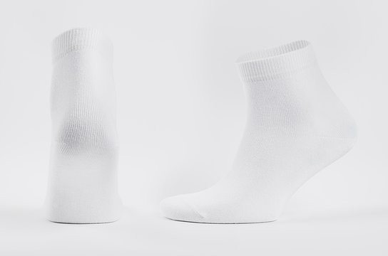 Blank white cotton medium sock on  invisible foot on white background as mock up for advertising, branding, design, back and side view, template.