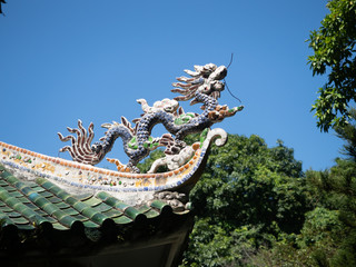 Dragon Figurine on the Roof of an Ancient Assembly Hall in Hoi An, Vietnam