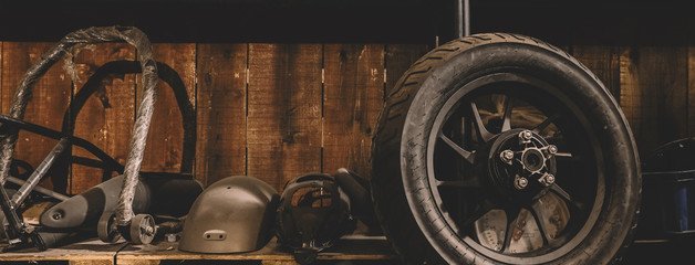Foto op Canvas Vintage cars Motorcycle wheel on the floor with workshop tools, vintage garage, with blank copy space