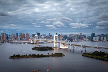 TOKYO, JAPAN - OCTOBER 6, 2019: The majestic Rainbow Bridge crossing northern Tokyo Bay between Shibaura Pier and the Odaiba waterfront.