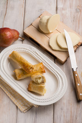 rolled up cheese filled with pear