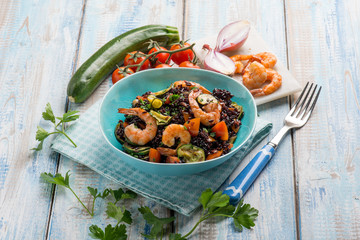 black rice with shrimp zucchinis and tomato