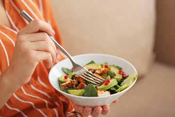 Woman eating tasty chicken salad, closeup