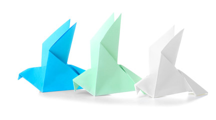 Origami birds on white background