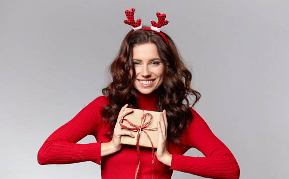 funny young woman in Christmas headband