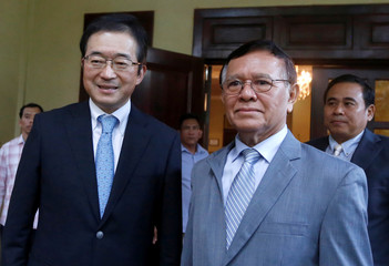 Leader of the Cambodia National Rescue Party (CNRP) Kem Sokha and Japanese Ambassador to Cambodia Masahiro Mikami pose for a picture at Sokha's home in Phnom Penh