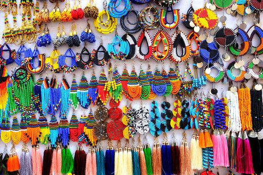 Tanzania Zanzibar handcrafted ethnic earrings on display board in Stone Town