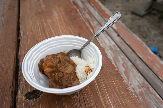 japanese food rice and curry in a disposable bowl outdoor