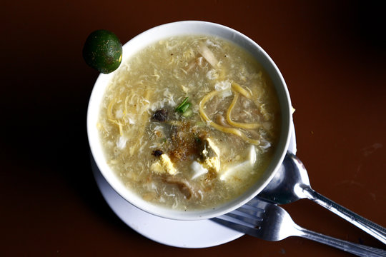 Freshly cooked Lomi or fat egg noodles with soup