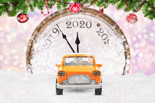 Taxi car on festive New Year and Christmas background. New Year 2020. Congratulations for taxi drivers.