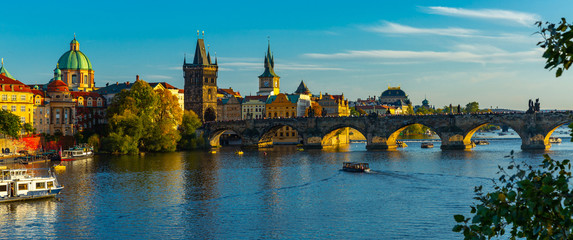 Poster de jardin Europe de l Est View of Charles bridge in autumn sunny day. Prague. Czech republic
