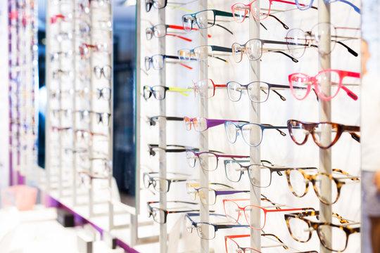 Glasses showcase in modern optic shop