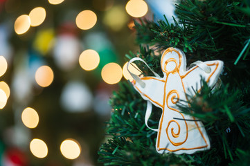 Christmas tree angel decoration on christmas tree background
