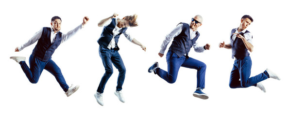A group of excited jumping students isolated on white background.