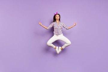 Full length body size view of her she nice attractive lovely sweet serene calm girl jumping meditating asana pose position isolated over violet purple lilac pastel color background