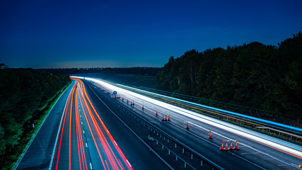 Spoed Foto op Canvas Nacht snelweg Long exposure of motorway at night