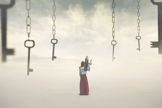 surreal image of a woman choosing a key among many hanging in the sky. Concept of solution, choice, password, success, freedom