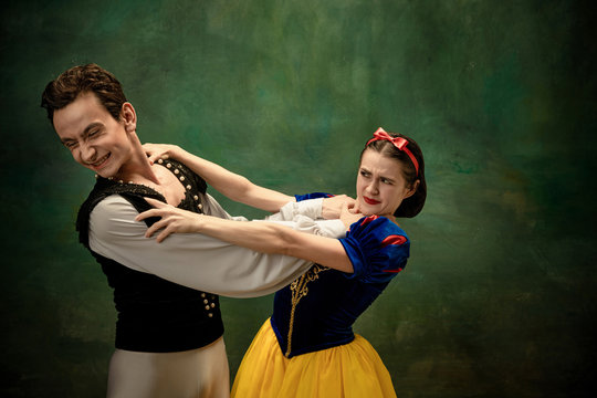 Young ballet dancers as a Snow White's characters in forest. Flexible artists dance like character of fairytail. Modern and elegance story with emotions. Comparison or eras. Swearing, angry.