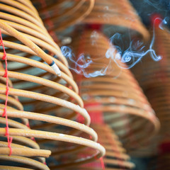 Burned coil swirl incense in Macau (Macao) temple,traditional Chinese cultural customs to worship god,close up,lifestyle.