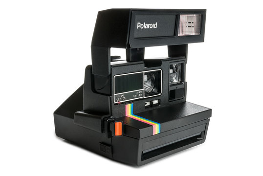 Retro Polaroid camera isolated on a white background. Clipping path included.