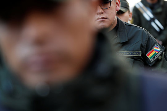 A badge with the Wiphala and Bolivian flags is seen in the uniform of a policeman during a ceremony at the General Command of the police in La Paz