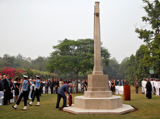 Britain's Prince Charles places a wreath at a memorial during his visit to Delhi War Cemetery in New Delhi