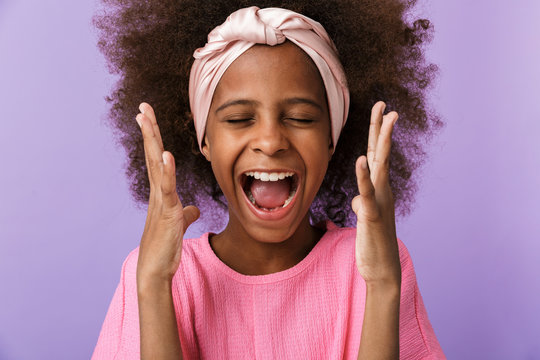 Screaming happy young african girl kid
