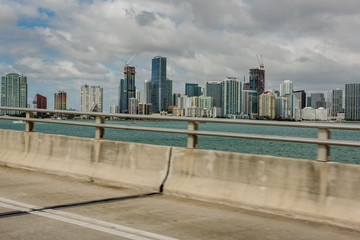 Fotobehang - View from the bridge at a speed to the bay and areas of the city of Miami, to the concentration of skyscrapers. USA. Florida. Miami